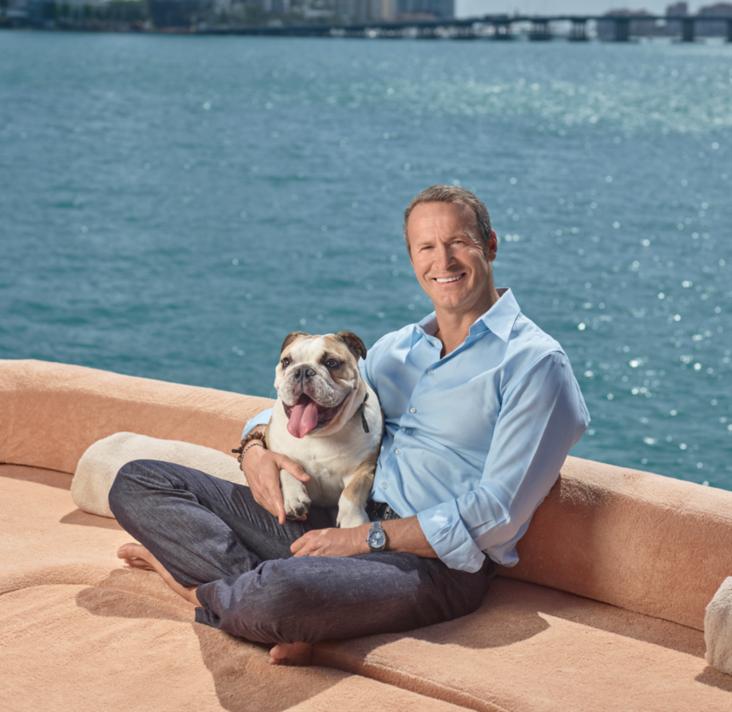 Vladislav Doronin with his English bulldog Mozart off the coast of Miami